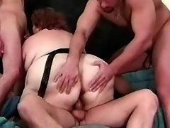 Horny BBW drinks fresh cum in orgy