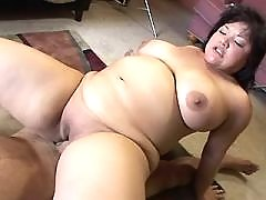Chubby asian babe gets cum on boobs