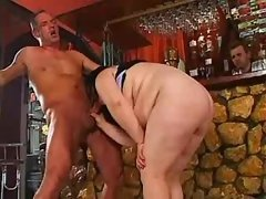 Man fucks busty BBW on floor in bar
