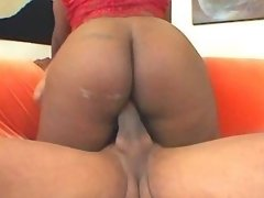 Guy hard fucks ebony fatty on sofa